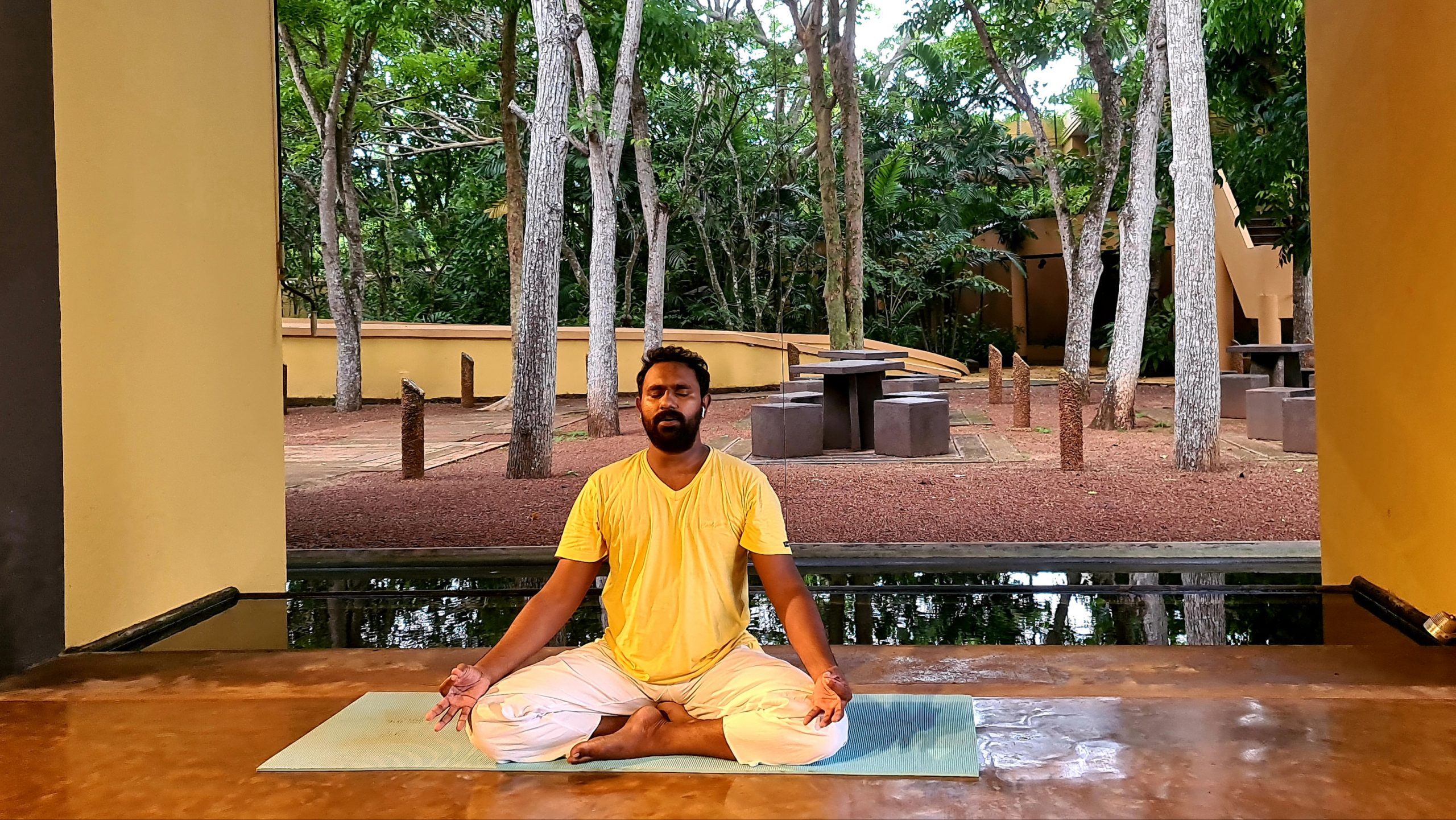Amesh seated in cross legged Yoga asana